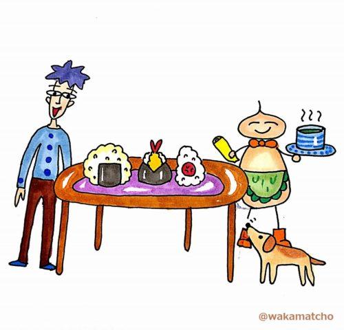 テーブルのおにぎりを見て喜んでいる画像。rice balls
